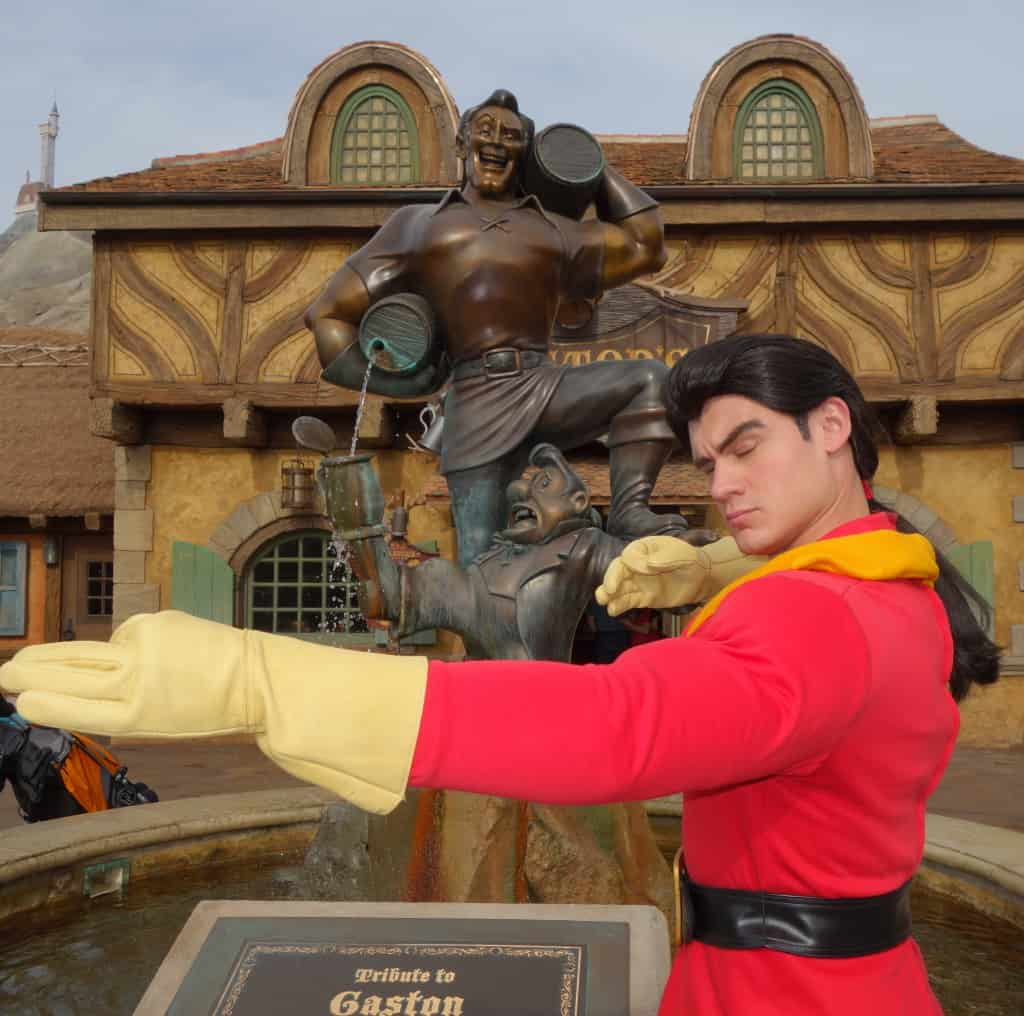 "Gaston demonstrates the proper technique for shooting an arrow of love into a young lady's heart.  He said he has 323 offers for marriage in the village but is just waiting on Belle to ""come to her senses."""