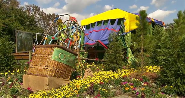One of the primary thematic elements is a crashed balloon full of spring color and flowers.