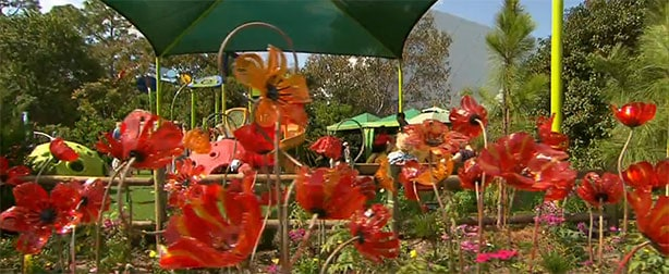 There is an assortment of real and Disney flowers to add beauty to the area.