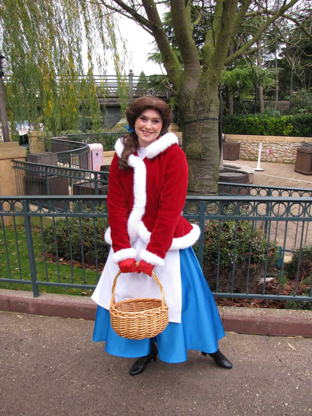 Belle wearing her Christmas outfit. Belle used to do Meet'n'Greets at her Village during the Christmas Season in the Disneyland Park. Sadly the Village didn't return during Christmas Season 2012/2013 and Belle did almost all her Meet'n'Greets in her yellow ball dress.