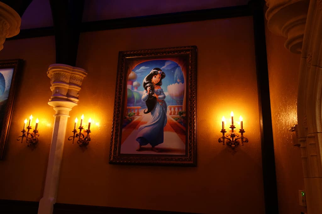The photo hall has several beautiful pieces of art for some of Disney's most popular Princesses.  They were actually drawn by the artist that creates the children's Golden Books. Jasmine will only appear here VERY rarely.  She STILL meets in Agrabah/Morocco.   If you see a CROWN on the photo outside, you might meet a less common princess.