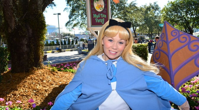 Alice in Wonderland in her winter costume at the Magic Kingdom's Fantasyland near the Mad Tea Party