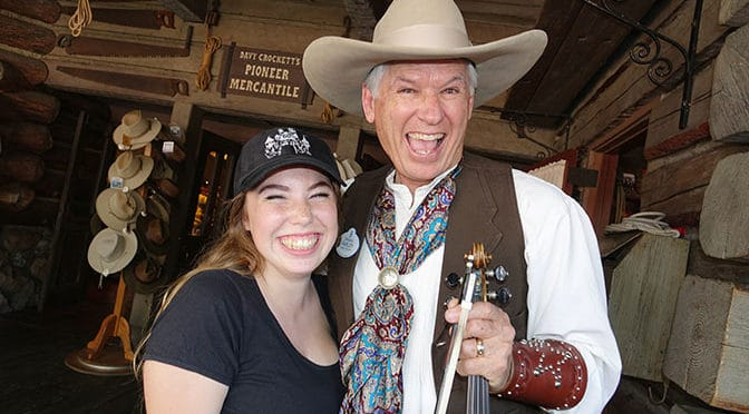 Farley the Fiddler gives my daughter a Fiddle playing lesson at Disneyland
