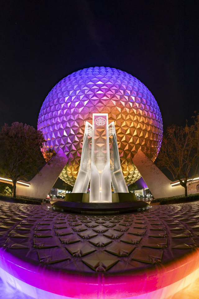 This image has an empty alt attribute; its file name is epcotpylonsnight.jpg