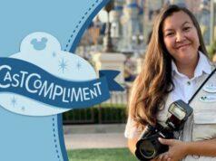 PhotoPass Cast Member helps guest get a special Magic Shot